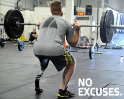 Image of a male amputee lifting weights.